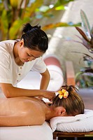 A beauty therapist gives a guest a massage at the Maia Luxury Resort & Spa