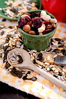 A table with several nuts, kernels and dried fruits