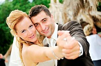 happy young and beautiful bride and groom at wedding party outdoor