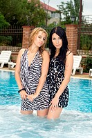 The two sexy playful girlfriends in pool