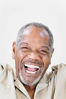 Portrait of a middle_aged man laughing