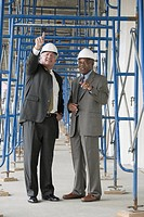 Two engineers discussing at a construction site