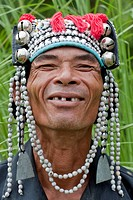 Portrait man from Asia, Akha, with traditional headdress