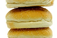 Fresh hamburger buns isolated against a white background