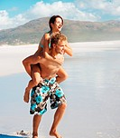 Young couple enjoying at the beach