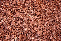 Simple red soil as background or texture