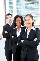 A diverse attractive man and woman business team FOCUS ON MIDDLE WOMAN