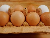 brown eggs on a wooden surface indoor