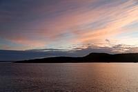 Silhouette of an island at dusk, Puerto Baquerizo Moreno, San Cristobal Island, Galapagos Islands, Ecuador