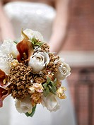 A closeup of bouquet held by a bride