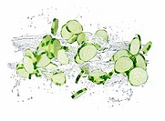 Cucumber slices with a splash of water