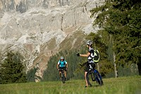 Two mountainbikers in the Dolomites, South Tyrol, Italy