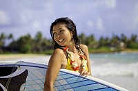 japanese woman with surfboard in hawaii