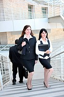 Attractive business woman team walking up stairs to work