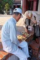Two men playing Xiangqi Chinese chess game, Ngoc Son, Jade mountain temple, Hoan Kiem park, Hanoi, Vietnam