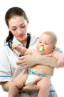 a doctor holding a baby on the hands