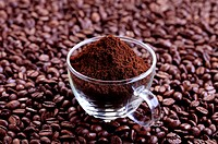 Freshly ground coffee in a glass cup