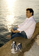 Man sitting on the waterfront