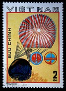 VIETNAM _ CIRCA 1980: A stamp printed in Vietnam shows Landing of a lowered part of a spacecraft, stamp from series honoring Intercocmos program, circ...
