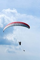 paraglider being lifted into the sky with a wire