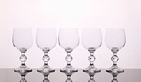 Five wineglasses isolated on the white background