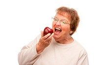 Attractive Senior Woman with Apple Isolated on a White Background.