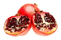 fresh juicy pomegranates , isolated on white background