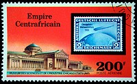 A stamp printed in Central African Empire in present time Republic shows postage stamp of airship on background of Museum of Sciense and industry Chic...
