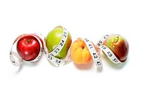 Tape Measure Around Fruits on White Background