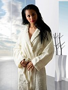 cute and young latina girl in white bathrobe