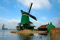 Traditional dutch windmills in the quaint village of Zaanse Schans, the Netherlands