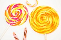 Two Multi_colored Lollipops on White Background
