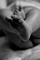 A black and white baby feet