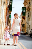 Mother and her little daughter outdoors in European city