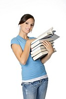 Beautiful Caucasian student with a hand full of books