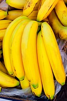 Big pile of fresh organically grown ripe bananas