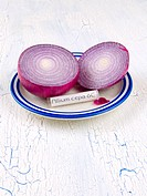 Allium cepa homeopathic medicine, made of red onion, with copy space, on a rustic white and blue table.