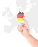 Finger touch on a future innovative transparent screen display Germany map flag