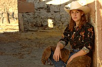 Cowgirl in stone barn