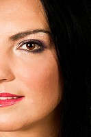 Close up of half face of beauty young woman with make up eye and black eyebrow
