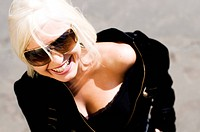 smiling blonde woman wearing sunglasses