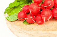 bunch of radishes on wooden board