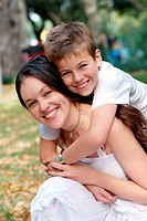 Happy mother and son in a park