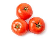 Three juicy, red tomatoes isolated on white background.