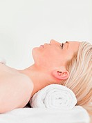 Releaxed blonde woman enjoying her treatment while lying down in a Spa centre