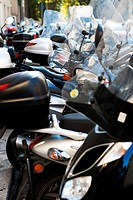 Lot´s of motorcycles parked on the street