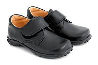 Child´s black shoes on a white background