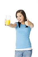 Beautiful Caucasian woman holding a glass of orange juice