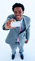 High angle of smiling Afro_American businessman holding a business card