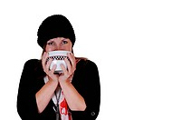 A middle aged woman drinking from a big cup some hot tee, with a sweater,scarf and hat on, with copy space on white background.